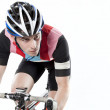 Young male cyclist on bike - Stock Photo