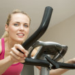Beautful young woman on exercise bike - Foto de Stock