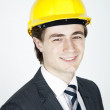 Young Man in Suit and Hard Hat - Stock Photo