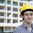 Young Man in Hard Hat on Site - Stock Photo