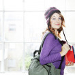 Female student carrying books and rucksack - Stock Photo