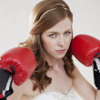 Beautiful bride in boxing gloves - Stock Photo