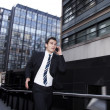 Man in Suit Running, on Mobile Phone - Stock Photo