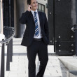 Man in Suit on Mobile Phone - Stock Photo