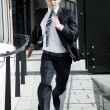 Man in Suit Running - Stock Photo
