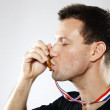 Kissing a gold medal - Stock Photo