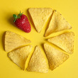 Tortilla Chips in a Circle with One Strawberry - Stock Photo