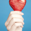 Royalty-Free Stock Photo: Female hands holding a red heart