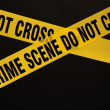 Crime scene do not cross cordon tape - Stock Photo