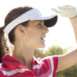 Beautiful female golfer - Stok fotoraf