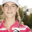 Beautiful female golfer - Stock Photo