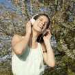 Beautiful summer girl with headphones - Zdjęcie stockowe