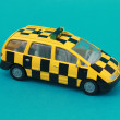 Stock Photo: Taxi toy isolated