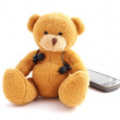 Teddy listening to music — Stock Photo