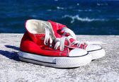 Pair of red sneakers — Stock Photo