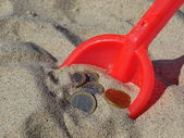Money in the sand — Stock Photo