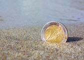 Euro coin on sand — Stock Photo