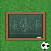 Realistic blackboard on wooden background drawing a soccer game  — Zdjęcie stockowe