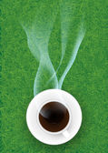 Coffee cup against grasses background. — Foto Stock