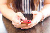 Close up of hands woman using cell phone. — Stock Photo