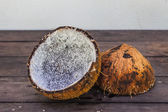 Coconut on table background — Stock Photo