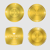 Guarantee of blank round polished gold metal badges on white bac — Vetorial Stock