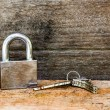 Key and lock on wooden background — Stock Photo #51434283