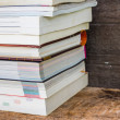Old books on a wooden shelf. No labels, blank spine. — Stock Photo #51434753