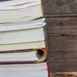 Old books on a wooden shelf. No labels, blank spine. — Stock Photo #51434815