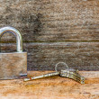 Key and lock on wooden background — Stock Photo #51434961