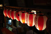 Light up traditional red and white Japanese paper balloons in Tokyo, Japan — Stock Photo