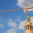 Royalty-Free Stock Photo: Construction site of mosque with tower crane and blue sky in Moscow, Russia