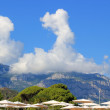 Mountain in Turkey (Kemer) with cloud forming a pointy hat - Stock Photo
