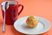 Cheese muffin and a cup of tea — Stock Photo