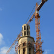 Royalty-Free Stock Photo: Construction site of a mosque with a tower crane and blue sky