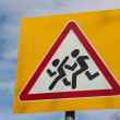 Caution children crossing road sign — Stock Photo