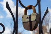 Large rusty iron padlock, selective focus — Stock Photo