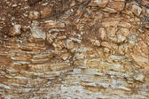 Crumbling layered rock — Foto Stock