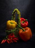 Multi-coloured pepper on black background — Stock Photo