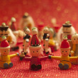 Christmas toys and Christmas tree ornaments on red background — ストック写真