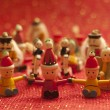 Christmas toys and Christmas tree ornaments on red background — Photo