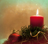 Christmas decoration with ball, candle and leaves — Stock Photo