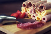 Slices of ham, salami and cheese — Stock Photo
