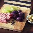 Stock Photo: Slices of salami and black and green olives