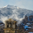 Royalty-Free Stock Photo: A mountain house roof with smoking chimney