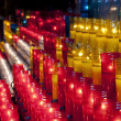 Royalty-Free Stock Photo: Church red yellow and white votive candles Montjuic Barcelona