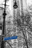 NEW YORK Dec,8 A view in black and white of with aids plaza with blue sign — Stock Photo