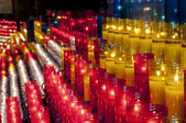 Church red yellow and white votive candles Montjuic Barcelona — Stock Photo
