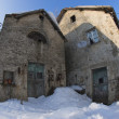 Old stone house in snow winter time — Stock Photo