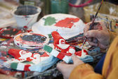 Hands while painting a paper puppet in Viareggio Italy Carnival Show — Stock Photo
